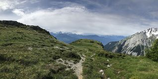 Hiking in Swiss Alps Royalty Free Stock Photography