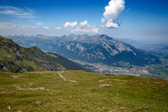 Hiking in swiss alps Royalty Free Stock Image