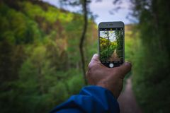 When hiking, take pictures with your mobile phone Stock Photos