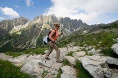 Hiking in Tatra Mountains, Slovakia. Female is trekking in Tatra Mountains. Trail to Rysy peak Stock Image