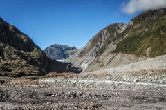 Hiking at the terrains to Franz & Fox glaciers in New Zealand in Royalty Free Stock Photo