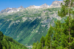 Hiking to Argentiere glacier with the view on the massif des Aiguilles Rouges in French Alps stock images