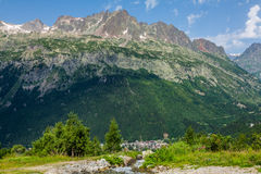 Hiking to Argentiere glacier with the view on the massif des Aiguilles Rouges in French Alps royalty free stock photo