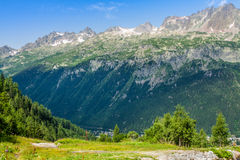 Hiking to Argentiere glacier with the view on the massif des Aiguilles Rouges in French Alps stock photo