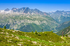 Hiking to Argentiere glacier with the view on the massif des Aiguilles Rouges in French Alps royalty free stock photography
