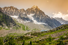 Hiking to Argentiere glacier with the view on the massif des Aig Royalty Free Stock Photo