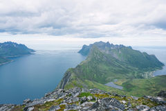 Hiking to Barden Mountain, Senja, Norway. View from Barden Mountain to Fjordgard stock photo