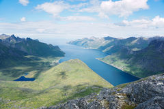 Hiking to Barden Mountain, Senja, Norway. View from Barden Mountain to Fjordgard and Husoy stock photography