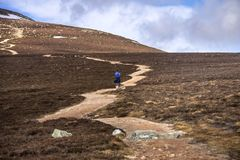 Hiking to Mount Keen summit. Cairngorm Mountains, Aberdeenshire, Scotland. Route to Mount Keen. Aberdeenshire, Cairngorms National Park, Scotland, UK royalty free stock photo