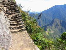Hiking to the top of Machu Picchu mountain to admire Machu Picchu from afar on a beautiful day in May. royalty free stock image