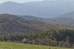 Hiking Together Into the Colorful Mountains Royalty Free Stock Photography