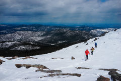 Hiking on the top of the snow mountain. Group of people are hiking on the top of the mountain with snow in Colorado Stock Images