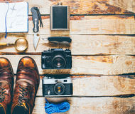 Hiking Tourism Travel Accessories. Adventure Discovery Holiday Activity Concept. Hiking accessories on wooden background: old hiking leather boots, vintage film stock photos