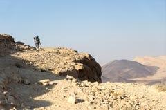 Hiking tourist in desert trek adventure stock images