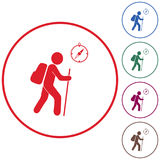 Hiking tourists with compass icon Royalty Free Stock Photos