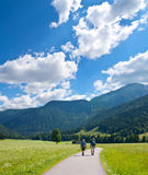 Hiking tourists in mountains Stock Photo