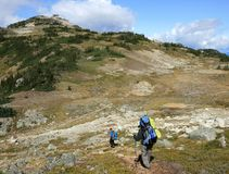 Hiking Towards Piccola Summit. Backpackers approaching Piccola Summit near Whistler, British Columbia, Canada Stock Photos
