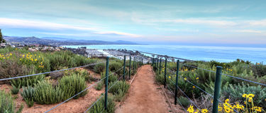 Hiking trail above Dana Point city view at sunset. In Southern California, USA stock photos