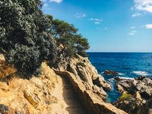 A hiking trail along the cliffs for tourists on Costa Brava of the Mediterranean Sea in Spain near Lloret de Mar Royalty Free Stock Image