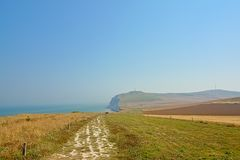 Hiking trail along a field toward the cliffs of Cap gris nez on the French North sea coast,. On a hazy morning royalty free stock images