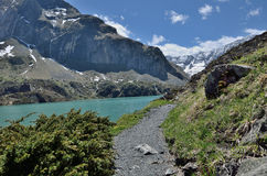 Hiking trail along the moutain lake Stock Photos