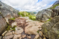 Hiking trail and alpine landscape of the Preikestolen Stock Photos