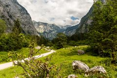 Hiking trail in the Alps stock images