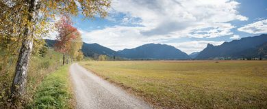 Hiking trail and bikeway along idyllic moor landscape from unterammergau to oberammergau. Hiking and cycle way along idyllic autumnal moor landscape from royalty free stock photos
