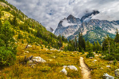 Hiking Trail in the Cascade Canyon - Grand Teton National Park. Hiking Trail thgrough the Beautiful Cascade Canyon - Grand Tetons stock photo