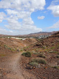 Hiking trail through characteristic landscape of Fuerteventura Royalty Free Stock Images