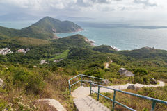 Hiking trail and coastline at the Lamma Island. View of hills, coastline and hiking trail at the Lamma Island in Hong Kong, China royalty free stock images