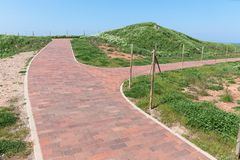 Hiking trail with crossroads at German island Helgoland in Northsea. Hiking trail of clinker bricks with crossroads at German island Helgoland in Northsea stock photos