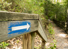 Hiking trail with directional arrow sign Royalty Free Stock Photography