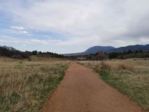 Hiking trail. Dirt hiking Trail royalty free stock images