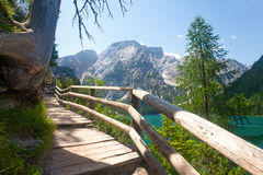 Hiking trail in the Dolomites. Hiking trail at Lake Braies in the Dolomites with the Seekofel mountain in the background, Sudtirol,Italy stock images