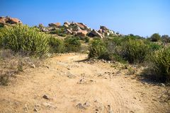 A hiking trail through a dry rocky Stock Photo