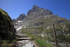 Hiking trail and east wall of Eiger mountain Royalty Free Stock Images