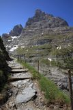 Hiking trail and east wall of Eiger mountain Stock Images