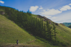 Hiking trail. Figure of a man walking in nature Stock Photos