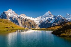 Encountering Bachalpsee when hiking First to Grindelwald Bernese Alps, Switzerland. royalty free stock photos