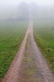 Hiking trail in fog Royalty Free Stock Image