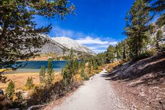 Hiking trail following the shoreline of Long Lake stock image