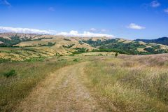 Hiking trail on the hills of north San Francisco bay, California. Sunny day with blue sky stock photos