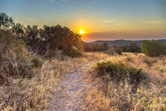 Hiking trail on hilltop in Cevennes. Hiking trail on hilltop at sunrise in Cevennes National Park, Southern France stock image