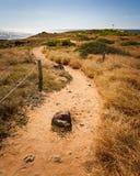 Hiking Trail Kaena Point National Park. Hiking path along the coastal seascape hiking trail of Kaena Point National Park on Oahu, Hawaii north shore stock photos