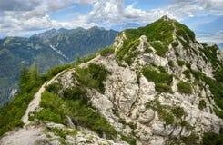 Hiking trail leading to the mountain peak Stock Photo