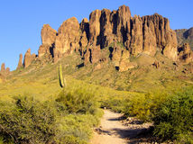 A hiking trail leads into the Superstition Mountains. Stock Photography