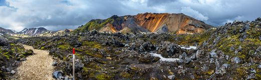 Hiking trail and a marker in beautiful colorful volcanic mountains Landmannalaugar in Iceland, summer time stock images