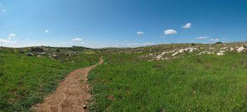 Hiking trail among Mediterranean hills in spring Royalty Free Stock Photography