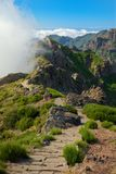 Hiking trail on the mountain peak. Pico do Arieiro on Madeira. Hiking trail on the mountain peak. Pico do Arieiro on Portuguese island of Madeira royalty free stock images